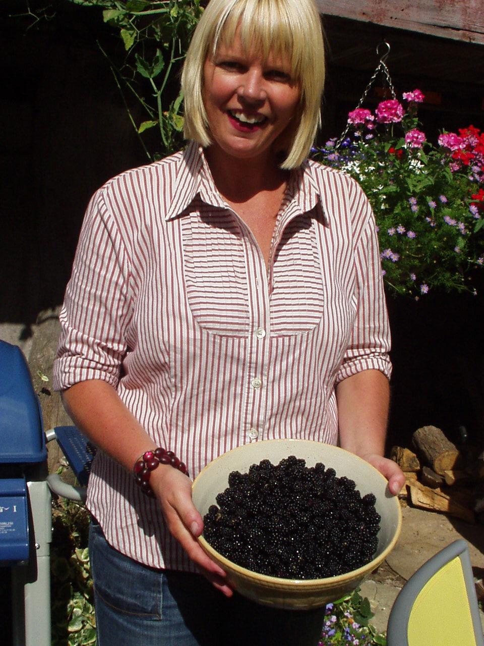 Jenny Kirwan (me!) looking pretty pleased with Sylvia's blackberries